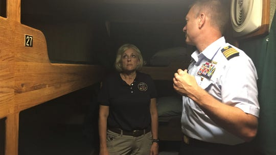 National Transportation Safety Board member Jennifer Homendy and Coast Guard Capt. Jason Neubauer tour the berthing area of small passenger vessel Vision, a similar vessel to Conception.