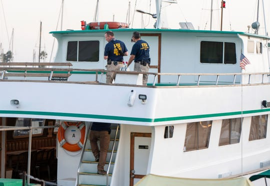 At Santa Barbara Harbor, FBI investigators comb over the Vision, a sister vessel to the scuba boat Conception, to document its layout and learn more about the fire that destroyed the Conception off Santa Cruz Island and killed 34 people.
