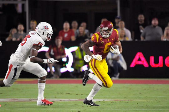 USC wide receiver Michael Pittman Jr. tries to get away from Fresno State linebacker Arron Mosby during the first half of last Saturday night's game at the Coliseum. Pittman, an Oaks Christian graduate, had six catches for 38 yards in a 31-23 win.