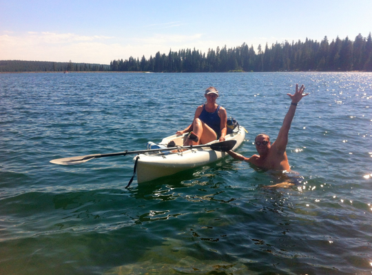 Thomas Ball swims with as his wife Jill Ball kayaks five years ago at Ice House Reservoir near Lake Tahoe.