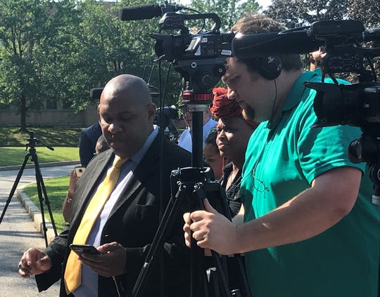 Fios1 News reporter Ray Raimundi and chief videographer Aaron Cipollina at the Sept. 4 news conference in support of news on the steps of New Rochelle City Hall.