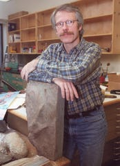 Paleontologist Paul Olsen, who discovered Rockland's dinosaur tracks in 1972, seen here in a file photo from 2000 at Lamont Doherty in Palisades with a dinosaur track found in Watchung, New Jersey.