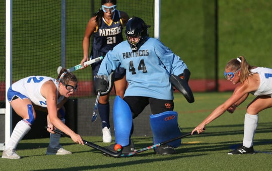 Panas goalie Kathryn Astrab (44) stops a shot from North Salem's Krista DeModna (22) during the second game of the Pleasantville's Autism Awareness Tournament at Pleasantville High School Sept. 3, 2019.  Panas won the game.