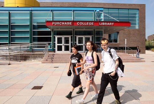 Students pass the library between classes at State University of New York at Purchase, also known as Purchase College, Sept. 4, 2019.