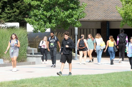 Students travel between classes at State University of New York at Purchase, also known as Purchase College, Sept. 4, 2019.
