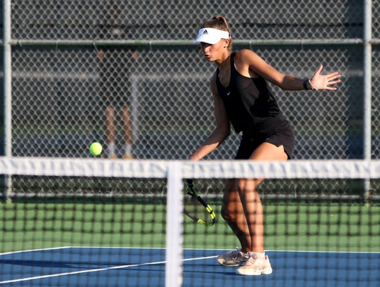 Rider's Axelle Jacquemin hits from inside the baseline in a doubles match against Denton Braswell Tuesday, Sept. 3, 2019, at Rider.