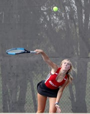 Wichita Falls High's Jessie Stephan serves in a doubles match against Hirschi Tuesday, Sept. 3, 2019, at Hirschi.