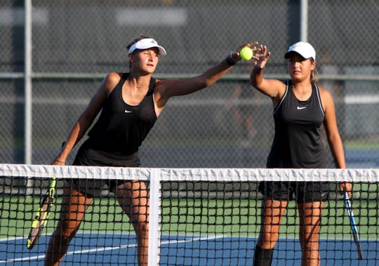 Rider's Axelle Jacquemin, left, catches the ball next to her doubles partner Eleny Sandoval-Almuna in a doubles match against Denton Braswell Tuesday, Sept. 3, 2019, at Rider.