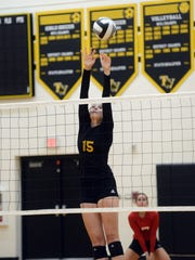 Tri-Valley's Abby Stanford goes up for a block against Sheridan on Thursday night in Dresden.