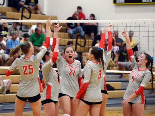 Sheridan players celebrate a point against Tri-Valley on Thursday night in Dresden.