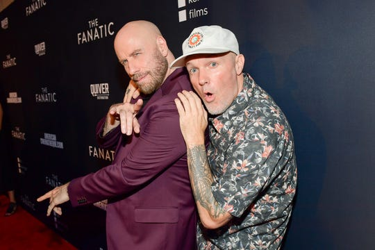 """John Travolta poses with Fred Durst, director and co-writer of """"The Fanatic,"""" at the film's premiere on Aug. 22, 2019 in Hollywood, Calif."""