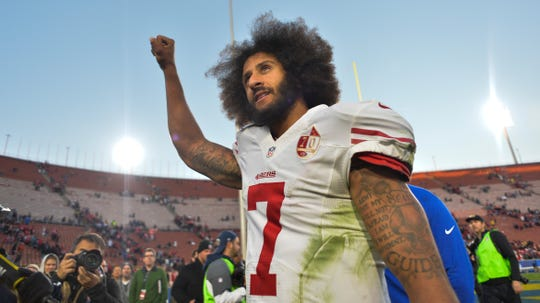 San Francisco 49ers quarterback Colin Kaepernick pumps his fist as he acknowledges the cheers of 49er fans after leading his team to a 22-21 come-form-behind win over the Los Angeles Rams at Los Angeles Memorial Coliseum on Dec. 24, 2016. It was his last NFL game.