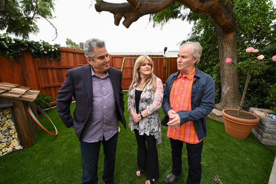 'The Brady Bunch' stars Christopher Knight, left, Susan Olsen and Mike Lookinland stand in the back yard of a Los Angeles home that's been transformed into a duplicate of the sitcom's Paramount Studios set as part of HGTV's 'A Very Brady Renovation.'