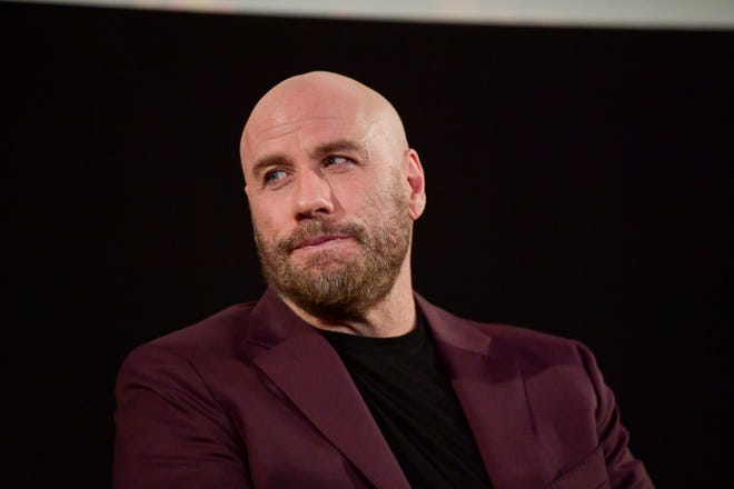 """John Travolta onstage at the premiere of his new thriller """"The Fanatic"""" on Aug. 22, 2019 in Hollywood, Calif."""