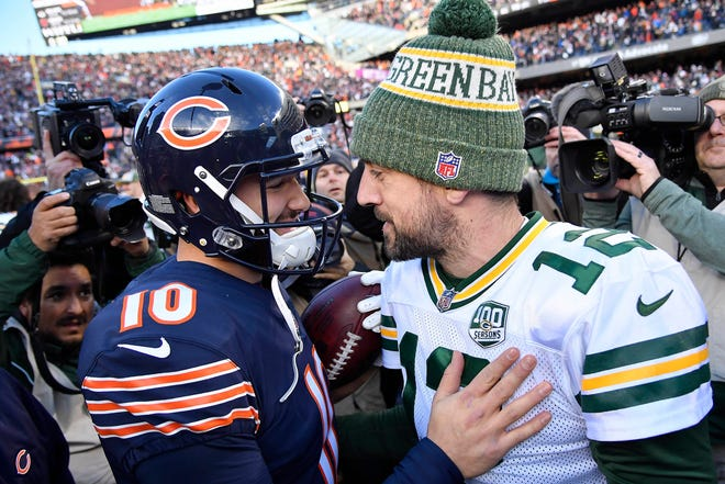 Chicago Bears quarterback Mitchell Trubisky (10) and Green Bay Packers quarterback Aaron Rodgers (12) meet on the field after the game at Soldier Field.