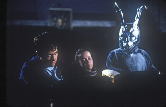 "Jake Gyllenhaal, Jena Malone and Frank the bunny in ""Donnie Darko."""