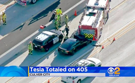 This Jan. 22, 2018, file still frame from video provided by KCBS-TV shows a Tesla Model S electric car that has crashed into a fire engine on Interstate 405 in Culver City, Calif.