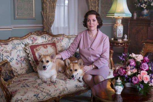Olivia Colman as Queen Elizabeth II with her famous corgis.
