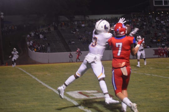 """ASH safety Ce'onte Frazier (3) breaks up a pass intended for Caldwell Parish's Cole Johnston during the Cenla Jamboree Aug. 30 at Pineville's D.C. """"Bill"""" Bates Stadium. The Trojan secondary intercepted 10 passes last season."""