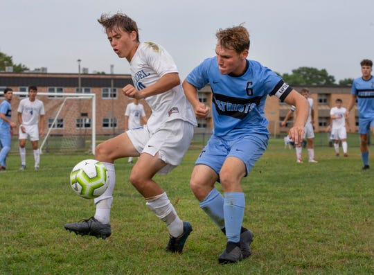 Holmdel's Connor Hinds tries to bring the ball down the sideline as he. works agains Freehold Township's Evan Savino. Holmdel Boys Soccer vs Freehold Township in Freehold NJ on September 5, 2019.