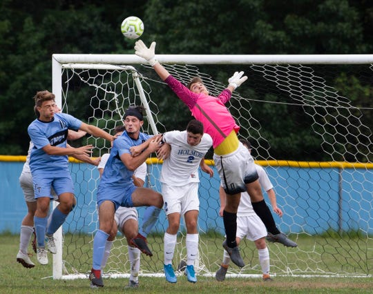 Holmdel goalie Tommy Shyzowych knocks away a shot on goal. Holmdel Boys Soccer vs Freehold Township in Freehold NJ on September 5, 2019.