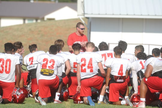Sweetwater coach Ben McGehee talks to his players following practice Sept. 4.