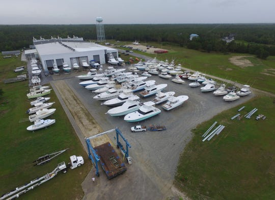 Boats are removed from the water at Winters Yachts in Swansboro N.C. as Hurricane Dorian moves up the East Coast on Sept. 4, 2019. (AP Photo/Tom Copeland)