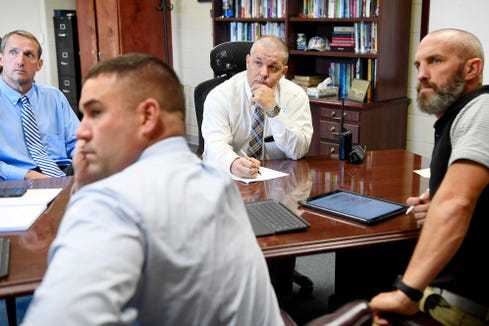 Tuscola principal Todd Tratham, center, listens as he examines a map of C.E. Weatherly Stadium with school officials from Pisgah September 3, 2019.