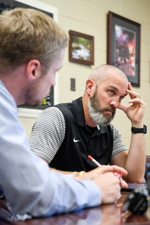 Pisgah athletic director Casey Kruk have a meeting with officials at Tuscola High School September 3, 2019, to plan for the rivalry game between the two schools.