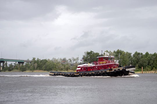 The Margaret McAllister tug boat drives up the Cape Fear River in Wilmington, North Carolina during a period of calm weather on Sept. 5, 2019.