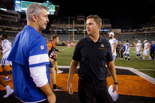 Cincinnati Bengals coach Zac Taylor, right, meets with Indianapolis coach Frank Reich after a preseason game Aug. 29, 2019, in Cincinnati. Taylor's first regular season game comes Sunday against Seattle.