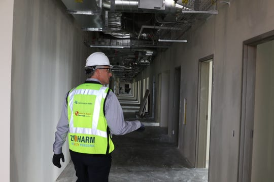 Harrison President David Schultz leads a tour of CHI Franciscan's hospital expansion in Silverdale in August.