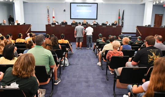 Viera Suntree Juniors coach Jason Allen and Majors coach Russell Cheatham stand before Brevard County commissioners Thursday afternoon in Viera. Commissioners recognized the two teams for their performance in the Little League World Series this season.