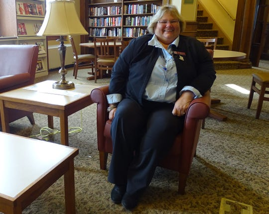 Retiring Bucyrus Public Library Director Brenda Crider says the fireplace area is her favorite spot in the library: It's where she got married three years ago.