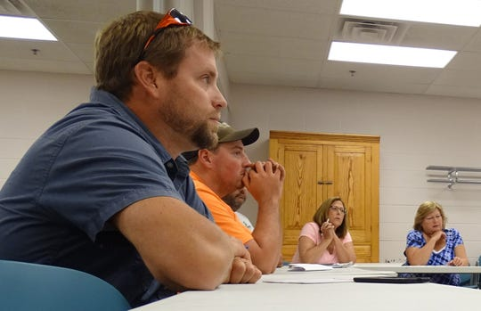 Jason Long, president of the Central Joint Ambulance District Board, and other township representatives listen during a Wednesday meeting about the possibility of creating a countywide ambulance district.