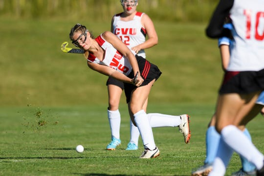 CVU's Hailey Chase (6) hits the ball down the field during the high school girls field hockey game between the South Burlington Wolves and the Champlain Valley Union Redhawks at CVU High School on Thursday afternoon September 5, 2019 in Hinesburg, Vermont.