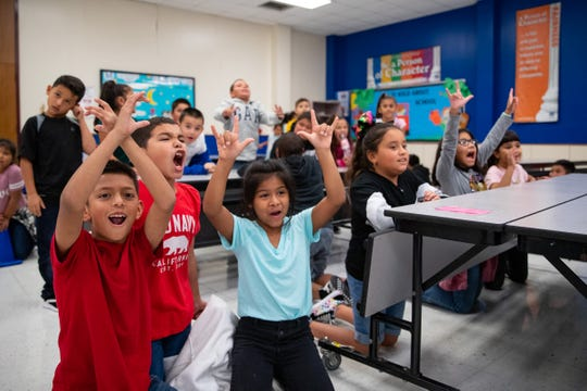 Crockett Elementary second-grade students cheer as a student spins the wheel to choose a house on Thursday, Sept. 5, 2019.