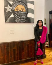 Artist Shawnick Rodriguez stands in front of one of her paintings. Her work will be part of a new Latin history exhibit at the Camden County Historical Society in Camden.