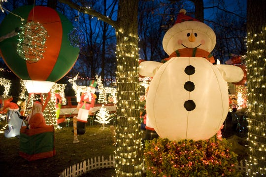 Two homes covered with lights, inflatables and lighted figures made Mercer Street in Cherry Hill a huge draw during the holiday season. The display will not be back because of deaths in both neighbors' families.