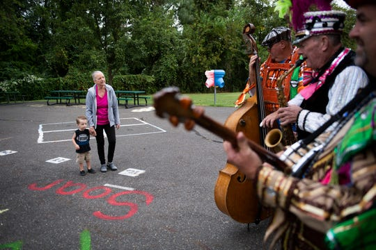Challen Reim, 2, watches alongside his grandmother Holly Williams as the Quaker City string band performs on the first day of school at Woodbury Heights Elementary Thursday, Sept. 5, 2019.