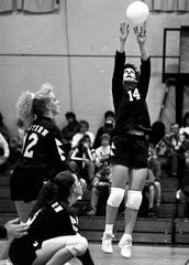 Marlene Stollings sets the ball for Eastern during a volleyball match against Huntington in 1992.