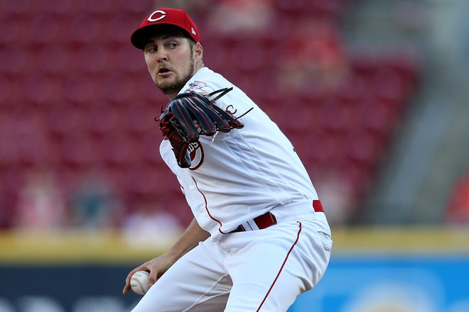 Cincinnati Reds starting pitcher Trevor Bauer (27) delivers in the first inning of an MLB baseball game against the Philadelphia Phillies, Wednesday, Sept. 4, 2019, at Great American Ball Park in Cincinnati.
