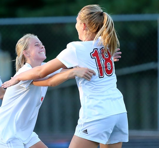 Indian HIll's Meghan O Brien, left, celebrates with senior captain Ellie Podojil after scoring a  goal during their  their soccer game against Madeira Wednesday, Sept. 4, 2019. Indian Hill won 3-0.