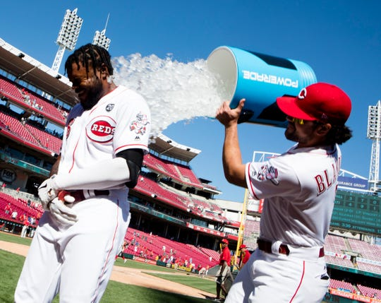 Cincinnati Reds right fielder Phillip Ervin (6) is dunked by /Cincinnati Reds shortstop Alex Blandino (2) after hitting a walk off home run to win the game 4-3 in the 11th inning of an MLB baseball game against the Philadelphia Phillies, Thursday, Sept. 5, 2019, at Great American Ball Park in Cincinnati.