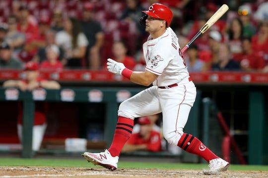 Cincinnati Reds left fielder Brian O'Grady (34) singles in the eighth inning of an MLB baseball game against the Philadelphia Phillies, Wednesday, Sept. 4, 2019, at Great American Ball Park in Cincinnati.
