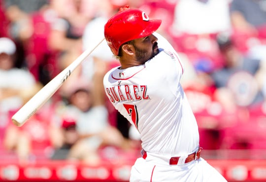 Cincinnati Reds third baseman Eugenio Suarez (7) hits his 41 home run in the sixth inning of an MLB baseball game against the Philadelphia Phillies, Thursday, Sept. 5, 2019, at Great American Ball Park in Cincinnati.
