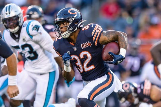 Chicago Bears running back David Montgomery (32) runs the ball against the Carolina Panthers during the first quarter at Soldier Field.