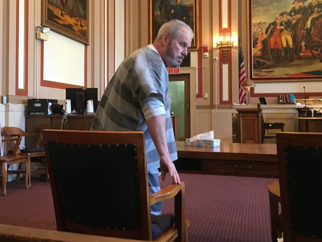 Harold White takes his seat at the defense table before hearing the verdicts in his trial Thursday in Hamilton County Common Pleas Court. A jury found White guilty of all 23 counts he faced.