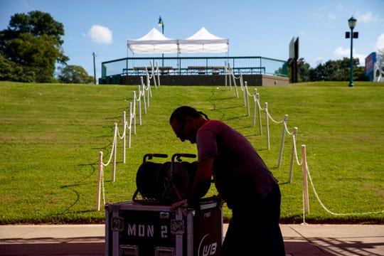 Rick Valles moves sound equipment across a stage area when preparing for Riverfest at McGregor Park in Clarksville, Tenn., on Thursday, Sept. 5, 2019.