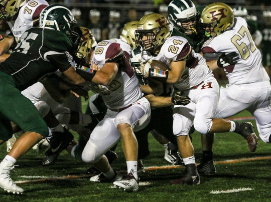 Sean Levonaitis (24) and Hillsborough welcome GMC power Colonia for a Week 0 opener